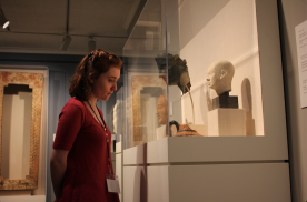 A girl stares at roman artifacts
