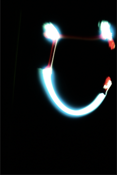 A smile made by low aperture and shutter speed.