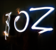 My sister, Zoe, spells out her name in the dark.