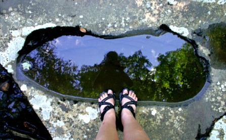 feet in a puddle
