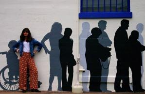 a girl against a wall